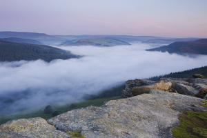 The Peak District hills with a cloud inversion covering the Ladybower Reservoir by Garry Ridsdale