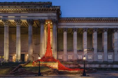 The Poppies Weeping Window sculpture cascading down the St. George's Hall building in Liverpool, Me by Garry Ridsdale