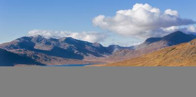 The road to the Scottish Highlands passing Loch Loyne and the distant mountains, Scotland, United K by Garry Ridsdale