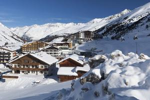 The Village of Obergurgl Sat Below the Huge Peaks of the Otztal Alps and Covered by Winter Snow by Garry Ridsdale