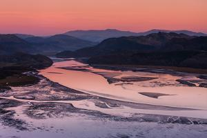 Twilight and Low Tide on Calm Mawddach Estuary Bordered by Mountains Within Snowdonia National Park by Garry Ridsdale