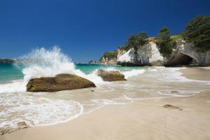 Waves Splashing Against Large Rocks on the Beach in Cathedral Cove, Coromandel, Waikato by Garry Ridsdale