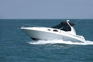 A White Speedboat at the Height of Summer. by Gary Blakeley