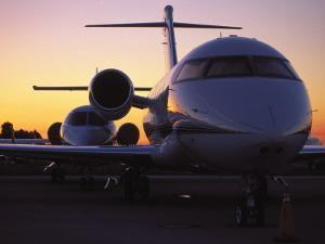 Business Jet Aircraft Parked at Airport by Gary Conner