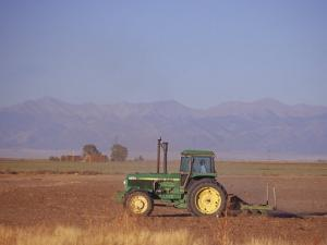 Farmer in Tractor, San Luis Valley, CO by Gary Conner