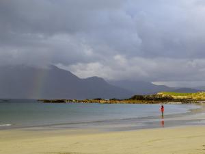 Lone Person on a Sandy Beach Under a Stormy Sky, Near Tully Cross, Connemara, Connacht by Gary Cook