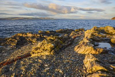 Rocky shore near Catacol looking out across the Kilbrannan Sound to Mull of Kintyre, Isle of Arran,