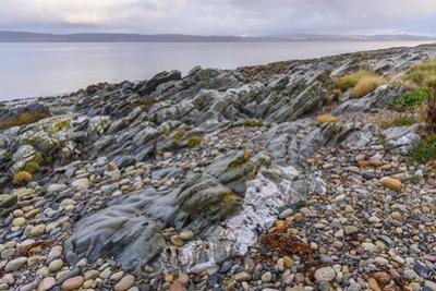Rocky shore near Pirnmill looking out across the Kilbrannan Sound to Mull of Kintyre, Isle of Arran