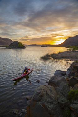 Sea Kayaker Paddling at Sunrise, Alkili Lake, Washington, USA by Gary Luhm