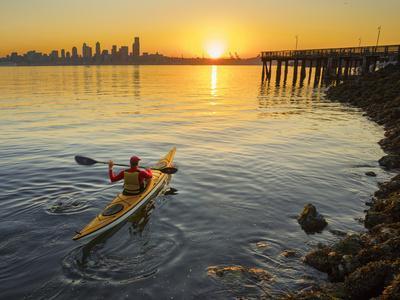 USA, Washington. Kayaker Paddling Sea Kayak on Elliott Bay