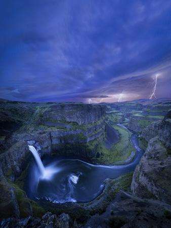USA, Washington State. Palouse Falls at dusk with an approaching lightning storm