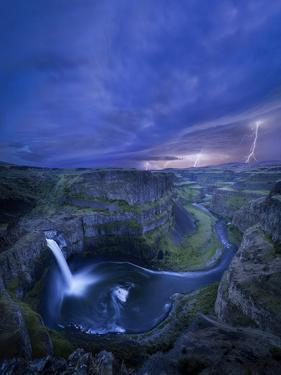 USA, Washington State. Palouse Falls at dusk with an approaching lightning storm by Gary Luhm