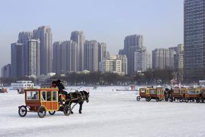 A Carriage on the Icebound Songhua River in Harbin, Heilongjiang, China, Asia by Gavin Hellier
