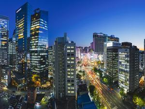 Busy Namdaemun-ro at Dusk in Myeong-dong, Myeongdong, Seoul, South Korea by Gavin Hellier