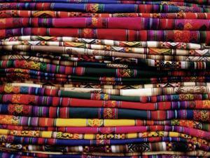 Detail of a Pile of Colourful Ponchos, Cuzco (Cusco), Peru, South America by Gavin Hellier