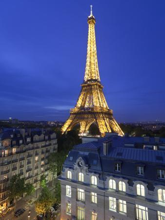France, Paris, Eiffel Tower, Viewed over Rooftops at Night by Gavin Hellier