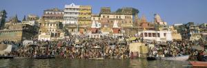 Hindus Bathing in Early Morning in Holy River Ganges Along Dasaswamedh Ghat, Varanasi, India by Gavin Hellier