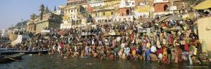 Hindus Bathing in the Early Morning in the Holy River Ganges Along Dasswamedh Ghat, Varanasi, India by Gavin Hellier