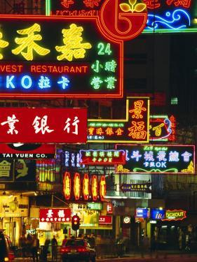Illuminated Neon Street Signs, Nathan Road in Tsimshatsui, Hong Kong by Gavin Hellier