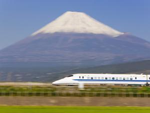 Japan, Houshu, Shinkansen (Bullet Train) Passing Mount Fuji by Gavin Hellier