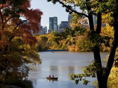 New York City, Manhattan, Central Park and the Grand Buildings across the Lake in Autumn, USA by Gavin Hellier
