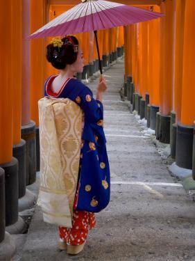 Portrait of a Geisha Holding an Ornate Umbrella at Fushimi-Inari Taisha Shrine, Honshu, Japan by Gavin Hellier