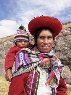 Portrait of a Local Woman in Traditional Dress, Carrying Her Baby on Her Back, Near Cuzco, Peru by Gavin Hellier