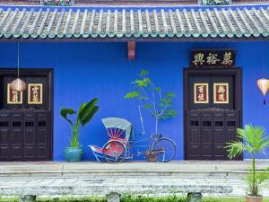 Red Rickshaw and Traditional Chinese Doorway, Chinatown District, Georgetown, Penang, Malaysia by Gavin Hellier