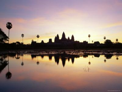 Reflections in Water in the Early Morning of the Temple of Angkor Wat at Siem Reap, Cambodia, Asia by Gavin Hellier