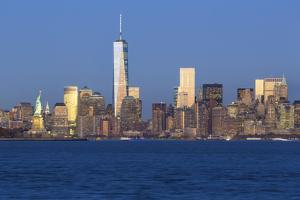 Statue of Liberty, One World Trade Center and Downtown Manhattan across the Hudson River by Gavin Hellier
