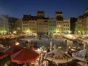 Street Performers, Cafes and Stalls at Dusk, Old Town Square (Rynek Stare Miasto), Warsaw, Poland by Gavin Hellier