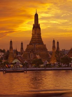 Thailand, Bangkok, Wat Arun ,Temple of the Dawn and Chao Phraya River Illuminated at Sunset by Gavin Hellier