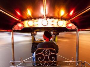 Tuk Tuk or Auto Rickshaw in Motion at Night, Bangkok, Thailand by Gavin Hellier