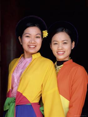 Two Smiling Vietnamese Women in Traditional Dress, North Vietnam, Vietnam by Gavin Hellier