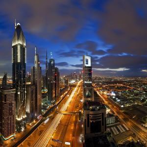 United Arab Emirates (UAE), Dubai, Sheikh Zayed Road Looking Towards the Burj Kalifa at Night by Gavin Hellier