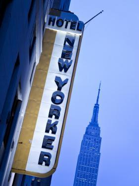 USA, New York City, Manhattan, New Yorker Hotel and Empire State Building by Gavin Hellier