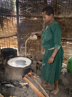 Woman Making Injera, the Staple Diet, Ethiopia, Africa by Gavin Hellier