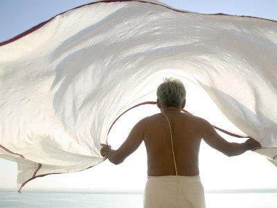 Man Dries His Lungi in the Winds by the Ganges