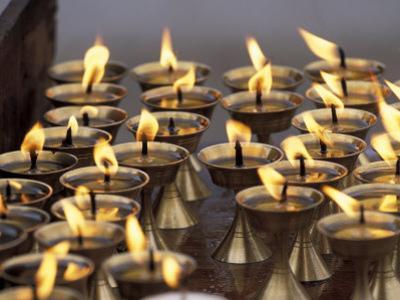 Bhuddist Temple with Candles, Kathmandu, Nepal by Gavriel Jecan