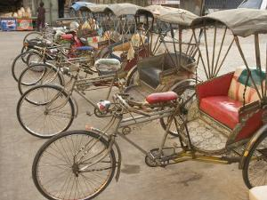 Bicycle Taxis, Khon Kaen, Thailand by Gavriel Jecan