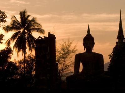 Buddha Statue and Sunset, Thailand by Gavriel Jecan
