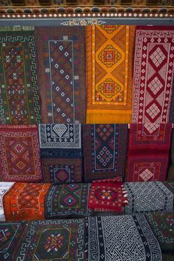 Carpets for sale at market, Bhutan. by Gavriel Jecan