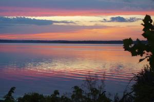 Brilliant sunrise over the Mississippi River near Montrose, Iowa by Gayle Harper