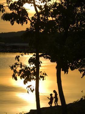 Kids Fishing at Sunset by Gayle Harper