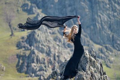 Youn Woman Wearing Black Dress Outdoor on Rocks