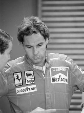 Gehard Berger Listening to a Member of the Ferrari Team, 1988