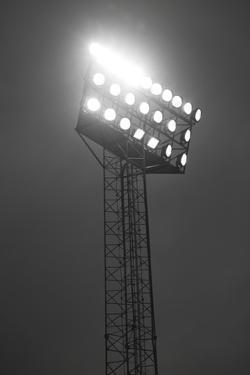 Stadium Spotlights Lit At Night by gemenacom