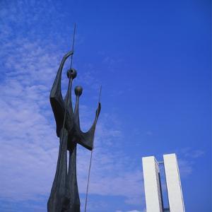Os Candangos Monument, Brasilia, Brazil by Geoff Renner