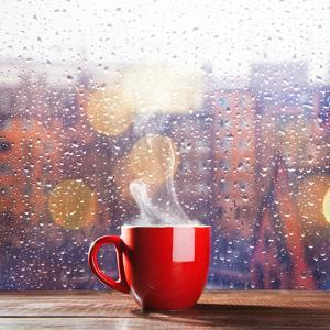Steaming Cup of Coffee over a Cityscape Background by George D.