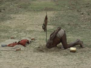 A Sadhu, or Holy Man, Buries His Head in a Feat of Breath Control Demonstrating His Mastery of Yoga by George F. Mobley